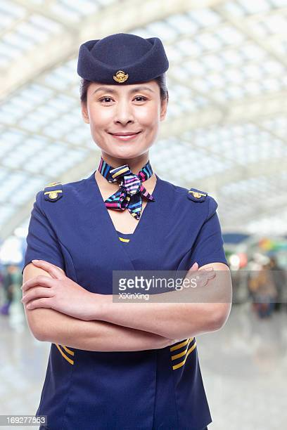 portrait of air stewardess - ネッカチーフ ストックフォトと画像