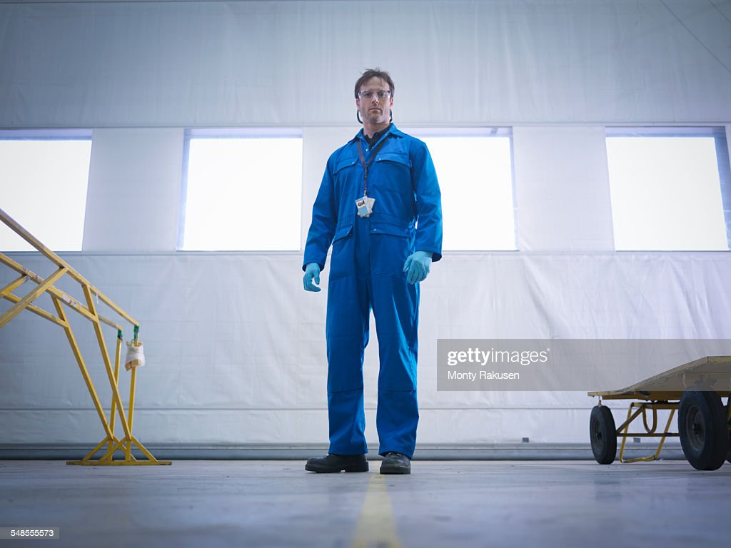 Coveralls Stock Photos And Pictures Getty Images Engineer Repairing Circuit Board Royalty Free Photo Image Portrait Of Aircraft In Maintenance Factory