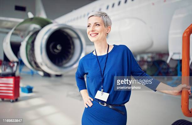 portrait of airplane hangar manager - air vehicle stock pictures, royalty-free photos & images