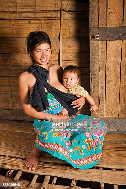 Portrait of Akha woman holding her baby in Northern Laos