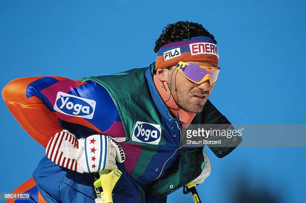 A portrait of Alberto Tomba of Italy resting on his ski poles during the FIS Mens World Cup Slalom ski event on 17 January 1991 in LechAustria