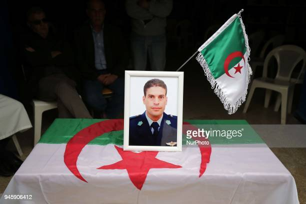 A portrait of Algerian copilot Sadiki Mahrez who died in the plane crash is seen in Algiers Algeria on April 13 2018 At least 257 people were killed...