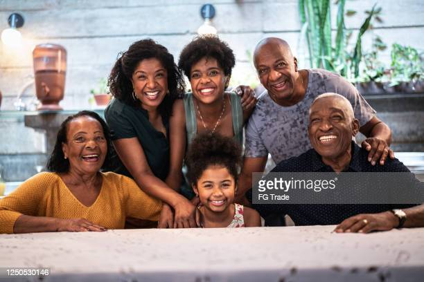 portrait of all family together at home - brazilian ethnicity stock pictures, royalty-free photos & images