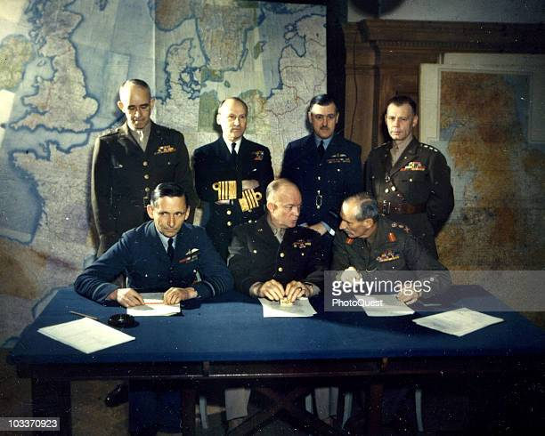 Portrait of Allied military commaders as they pose around a table England Spring 1944 Pictured are sitting from left British Air Chief Marshal Sir...