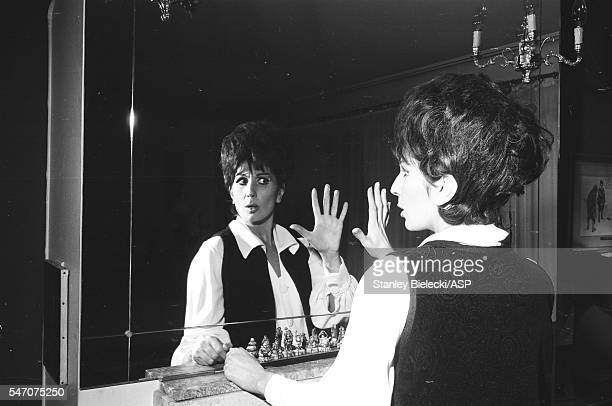 Portrait of Alma Cogan at home posing at a mirror London circa 1964