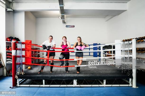 portrait of amateur kickboxers wearing sparring gear - boxing ring stock pictures, royalty-free photos & images