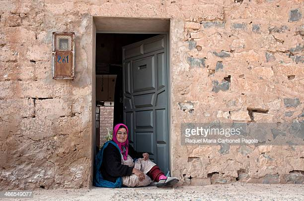 Portrait of amazigh/berber woman sitting at her house doorway