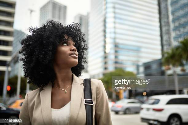 portrait of ambitious young african-american businesswoman - looking up stock pictures, royalty-free photos & images