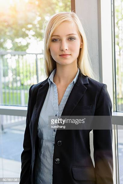 Portrait of ambitious young businesswoman in office