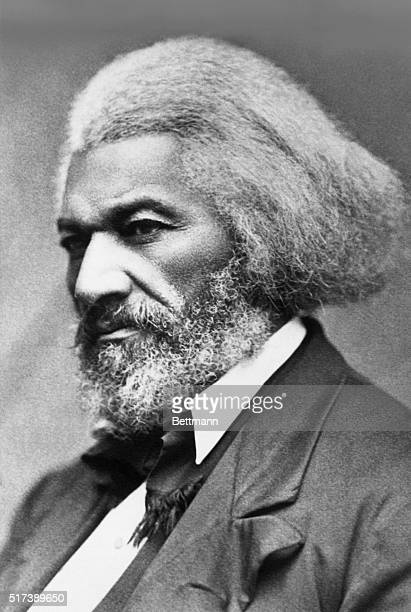 Portrait of American abolitionist and writer Frederick Douglass He is shown in near profile with gray hair and a beard Undated photograph