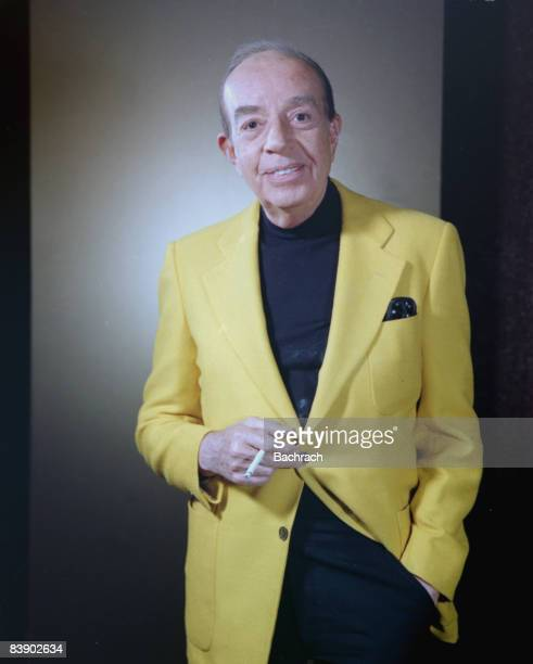 Portrait of American Academy award winning film director Vincente Minnelli, born Lester Anthony Minelli . He stands smiling with a cigarette in his...