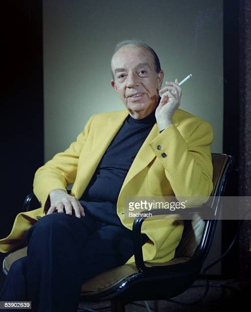 Portrait of American Academy award winning film director Vincente Minnelli born Lester Anthony Minelli He sits smiling with a cigarette in his left...
