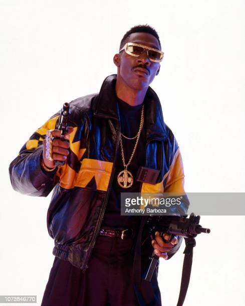 Portrait of American actor and comedian Charlie Murphy in costume for his role in the film 'CB4' as he poses in front of a white background New York...