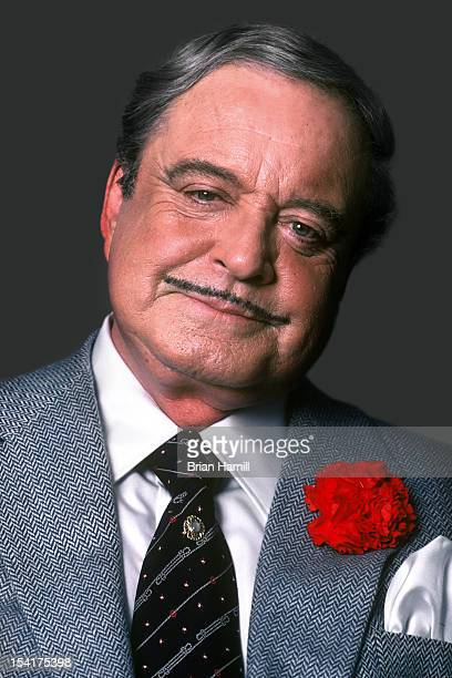 Portrait of American actor and comedian Jackie Gleason in a grey suit with a red carnation in jacket lapel New York New York July 1985