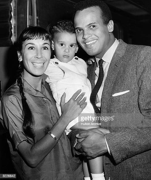 Portrait of American actor and singer Harry Belafonte posing with his wife American dancer Julie Robinson and their 22 monthold son David upon...