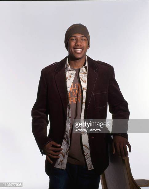 Portrait of American actor and singer Nick Cannon as he poses against a white background during a portrait session New York 1990s