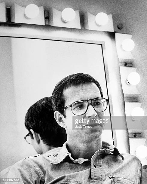 Portrait of American actor Anthony Perkins as he sits in front of an illuminated mirror in a dressing room Philadelphia Pennsylvania 1970
