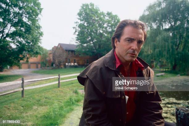 Portrait of American actor Armand Assante at his horse farm Campbell Hall New York 1996