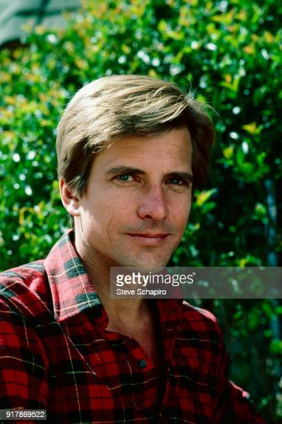 Portrait of American actor Dirk Benedict dressed in a plaid shirt as he poses outdoors Los Angeles California April 1985