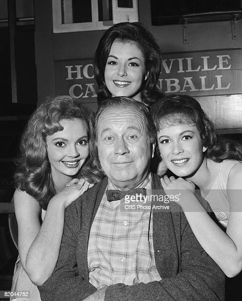 Portrait of American actor Edgar Buchanan as Joseph P 'Uncle Joe' Carson surrounded by fellow cast members from left Jeannine Riley Pat Woodell and...