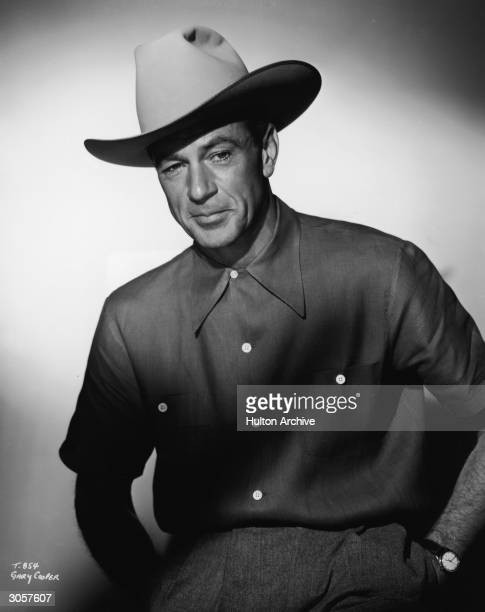 Portrait of American actor Gary Cooper , dressed in a cowboy hat and a short-sleeved shirt, 1950s.