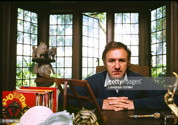 Portrait of American actor Gene Hackman as he sits at a desk California 1972