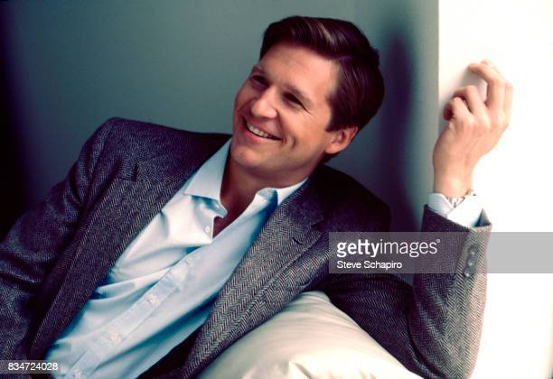 Portrait of American actor Jeff Bridges as he smiles one arm over the back of a couch Los Angeles California 1981