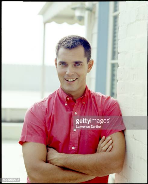 Portrait of American actor Jeffrey Hunter with his arms crossed as he leans against a wall Malibu California 1958