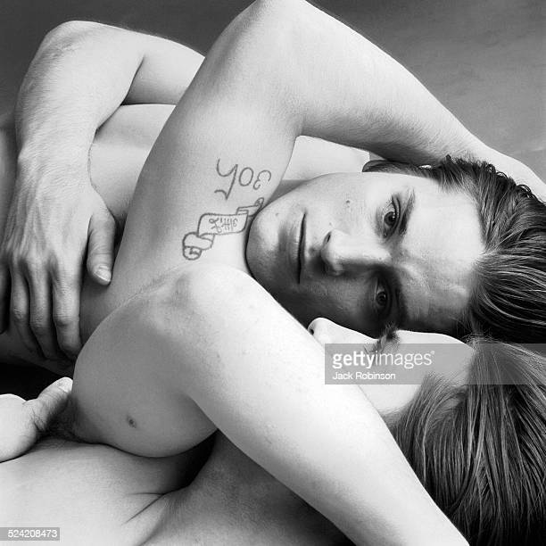 Portrait of American actor Joe Dallesandro as he poses in front of a mirror New York New York 1970