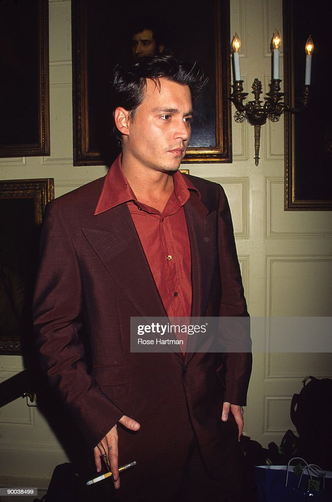 Portrait Of American Actor Johnny Depp A Cigarette And Holder In Hand As He