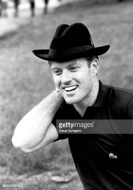Portrait of American actor Robert Redford in a black hat as he smiles in Central Park New York New York 1966
