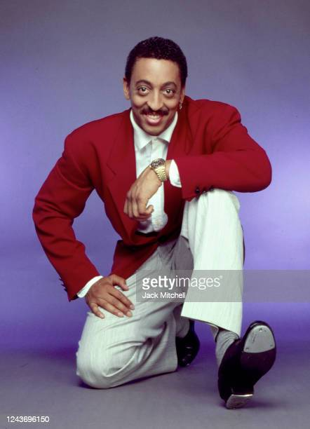 Portrait of American actor, singer, and dancer Gregory Hines as he poses in tap shoes, New York, New York, 1988.