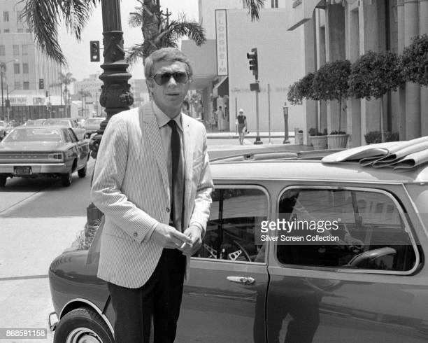 Portrait of American actor Steve McQueen as he stands on Wilshire Boulevard Los Angeles California 1960s