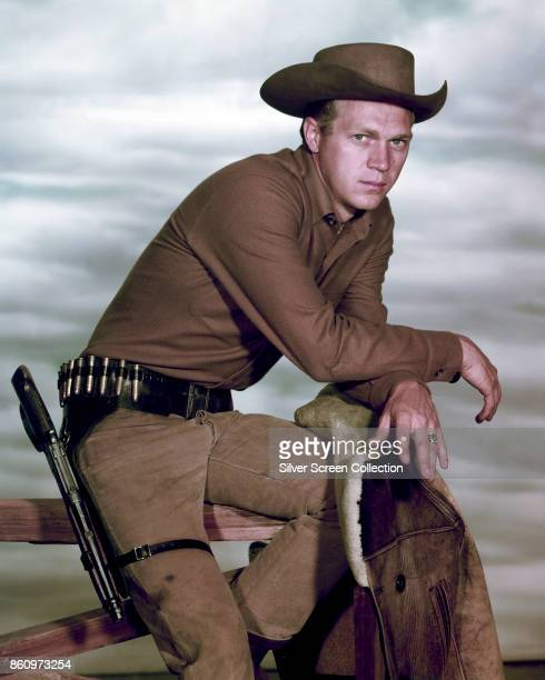 Portrait of American actor Steve McQueen perched atop a fence in the television series 'Wanted Dead or Alive' late 1950s or early 1960s