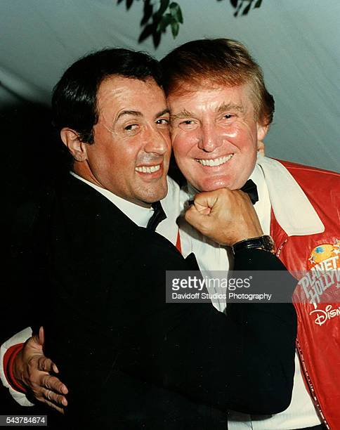 Portrait of American actor Sylvester Stallone as he mimes punching businessman Donald Trump on the chin at a charity event held at Bud and Marla...