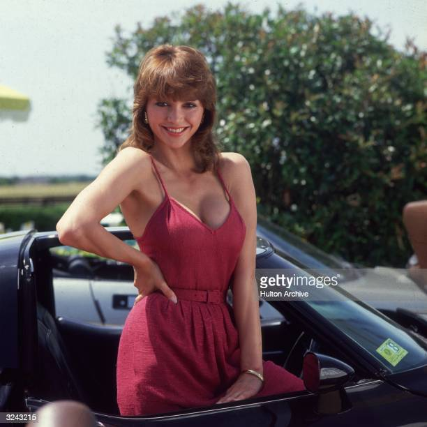 Portrait of American actor Victoria Principal best known for playing Pamela Barnes Ewing in the television serial Dallas wearing a red lowcut belted...