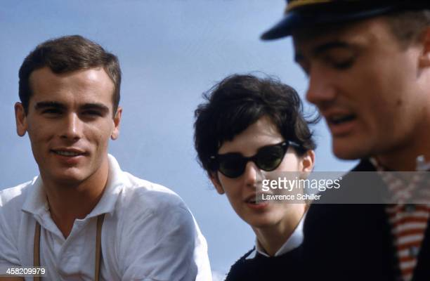 Portrait of American actors Dean Stockwell and Millie Perkins along with Stockwell's older brother fellow actor Guy Stockwell on a boat Newport Beach...