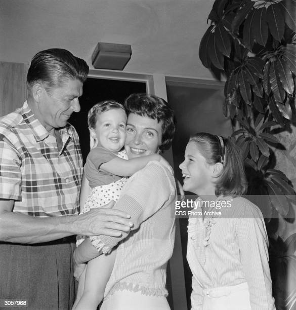 Portrait of American actors Ronald Reagan and Nancy Reagan and their children 2yearold Ronald Prescott Reagan and 9yearold Patricia Ann at the their...