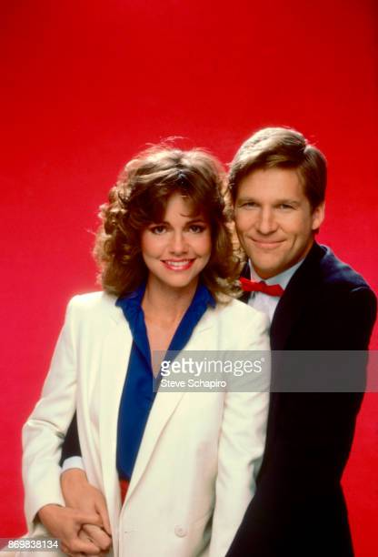 Portrait of American actors Sally Field and Jeff Bridges both in costume as they pose against a red background for the film 'Kiss Me Goodbye' Los...