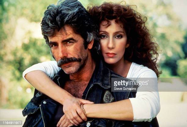 Portrait of American actors Sam Elliott and Cher on the set of the movie 'Mask' , Los Angeles, California, 1984.