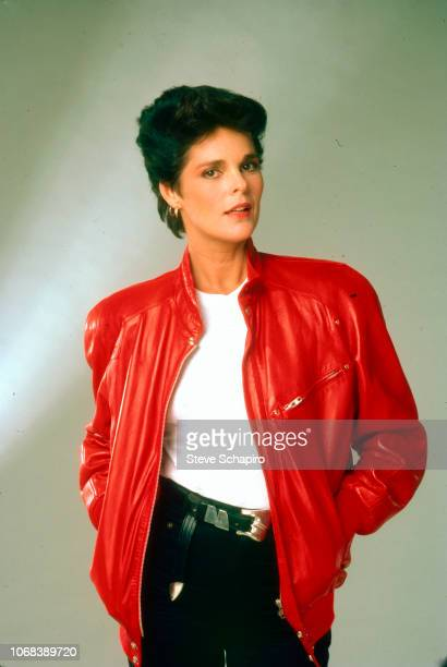 Portrait of American actress Ali MacGraw as she poses with her hands in the pockets of her red leather jacket Los Angeles California 1982