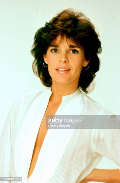 Portrait of American actress Ali MacGraw as she poses with one hand on her hip against a white background Los Angeles California 1982