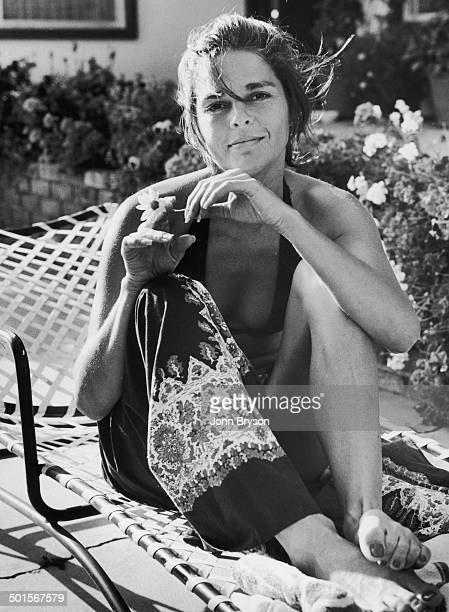 Portrait of American actress Ali MacGraw as she sits in deckchair California 1978