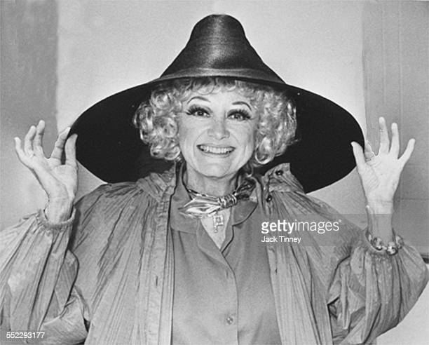 Portrait of American actress and comedienne Phyllis Diller smiles as she adjust an oversized hat Philadelphia Pennsylvania 1978