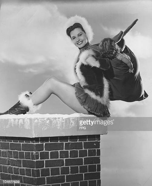 A portrait of American actress and dancer Cyd Charisse dressed in a Santa outfit circa 1940s