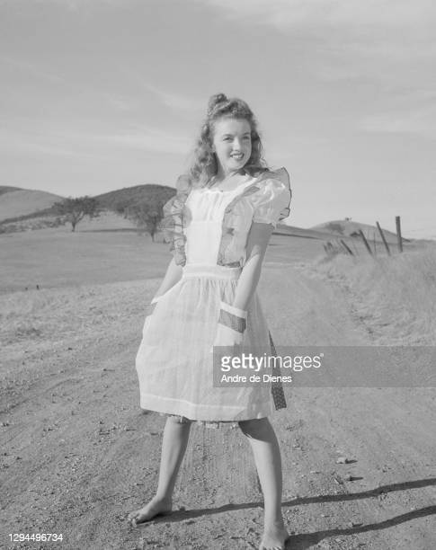 Portrait of American actress and model Marilyn Monroe in a pinafore dress, Northern California, 1945.