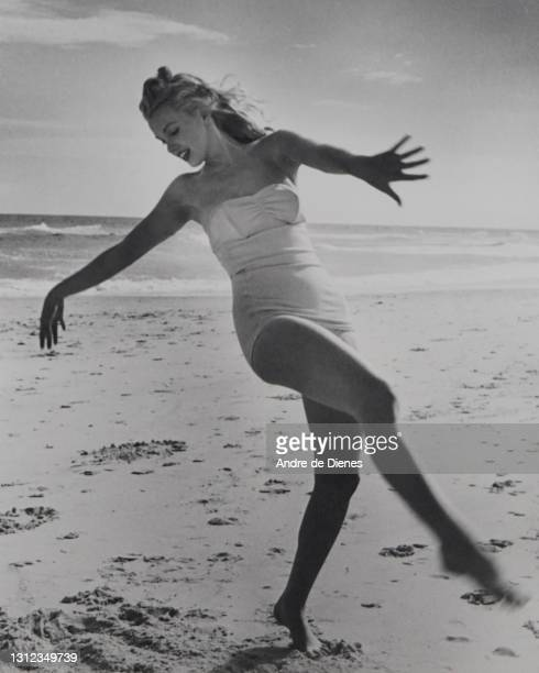 Portrait of American actress and model Marilyn Monroe , in a swimsuit, as she poses on Long Island's Tobay Beach, Oyster Bay, New York, 1949.
