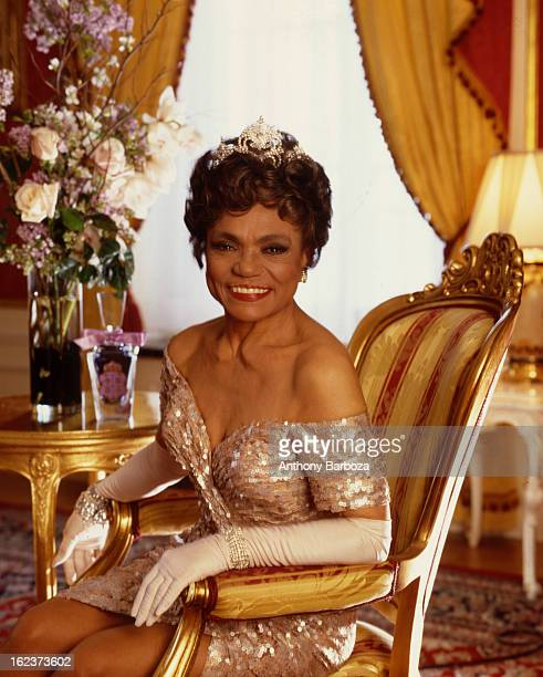Portrait of American actress and singer Eartha Kitt as she poses in a chair in a room at the Plaza Hotel New York New York 1992