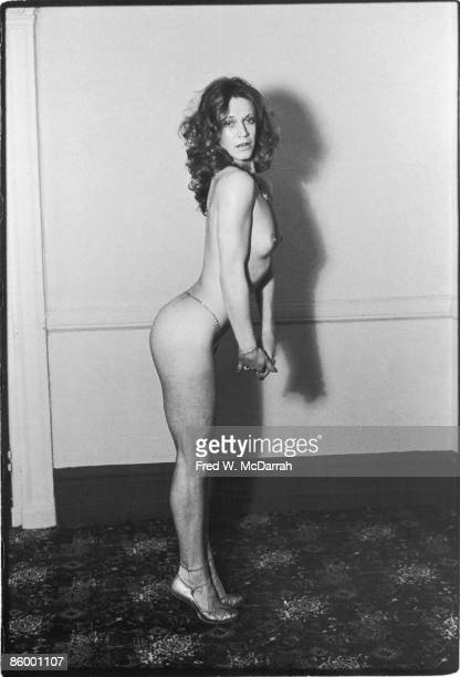 Portrait of American actress and singer Marilyn Chambers as she poses naked but for high heels and a belly chain New York New York March 15 1976