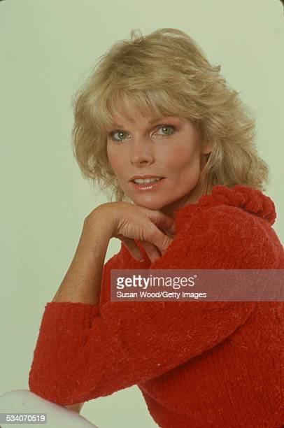 Portrait of American actress and television personality Cathy Lee Crosby as she poses in a red sweater July 1980
